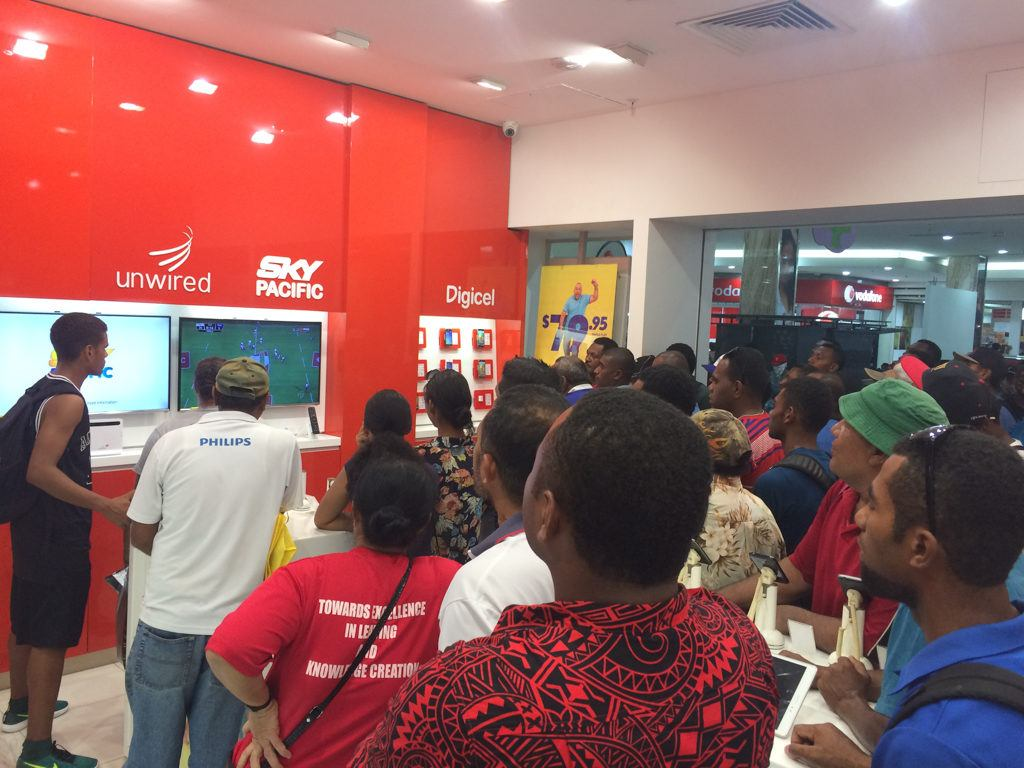 Watching rugby at the cell phone store in Fiji